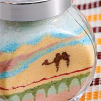 Рисунок из песка Верблюд